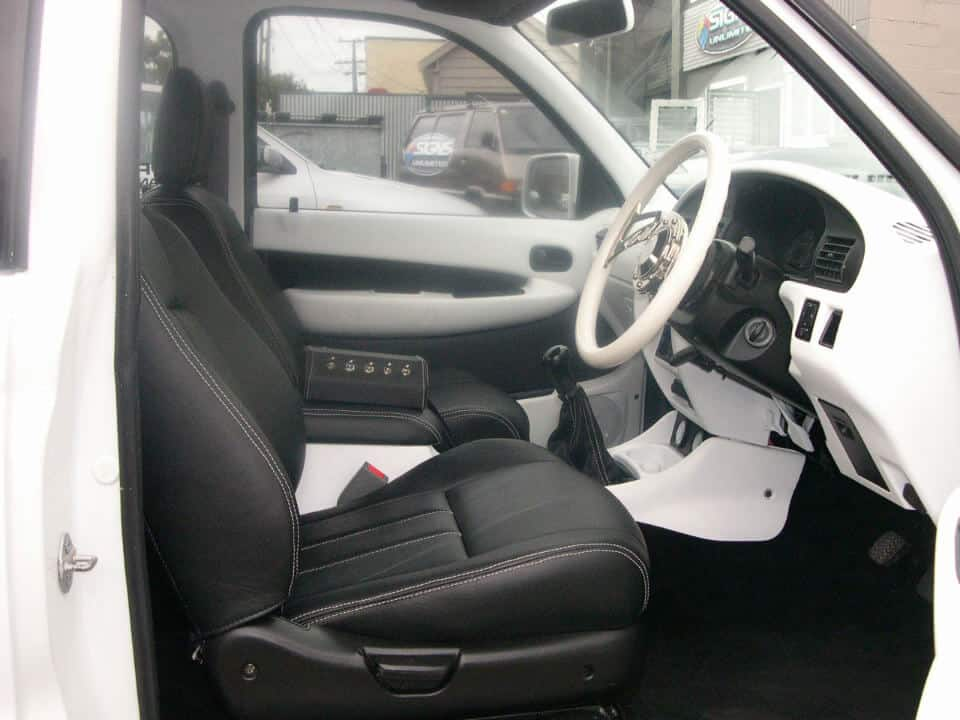 City-Trim-Speciality car works Seats-roof linings-carpeting-tonneau-covers-van-seats-white